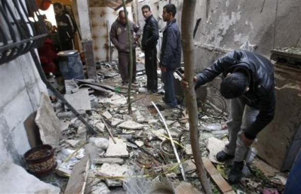 Palestinians inspect a house damaged in an Israeli airstrike in Gaza City, Saturday, March 10, 2012. The worst exchange of strikes between Israel and the Gaza Strip so far this year entered its second day on Saturday, as Israeli aircraft carried out raids that have so far killed 14 militants according to a Palestinian count, and militants responded with nearly 100 rockets. (AP Photo/Hatem Moussa)