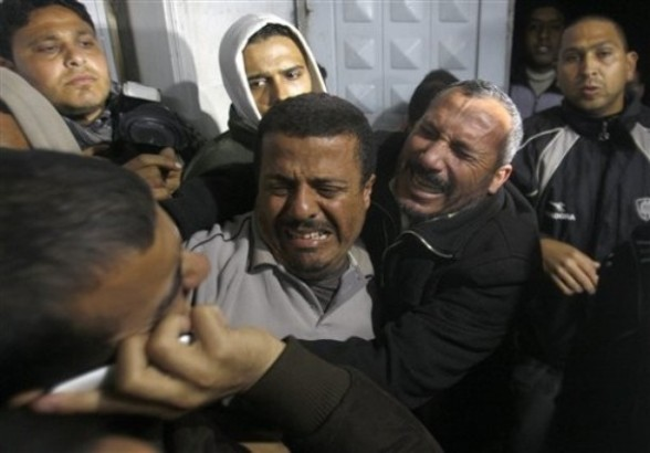 Relatives of a man killed in an Israeli airstrike mourn at a morgue in Gaza City, Friday, March 9, 2012. The Israeli military said in a statement that it targeted two rocket launching positions in the Gaza Strip Friday.