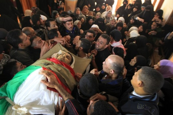 Palestinian mourners carry the body of an Islamic Jihad militant, who was killed in an Israeli air strike, during a mass funeral in Al-Omari mosque in Gaza City on March 10, 2012. Israeli air strikes on Gaza killed 14 Palestinians, including a militant group chief, medics said on March 10, in the deadliest 24 hours in the border area in more than three years. AFP PHOTO/MAHMUD HAMS