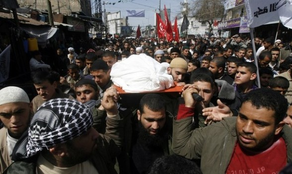 Palestinian mourners carry the body of Zohair al-Qaisi, general secretary of the Popular Resistance Committees (PRC), after he was killed the day before in an Israeli air strike, during his funeral in Rafah in the southern Gaza Strip on March 10, 2012. Israeli air strikes on Gaza killed 14 Palestinians medics said on March 10, in the deadliest 24 hours in the border area in more than three years. AFP PHOTO/STR