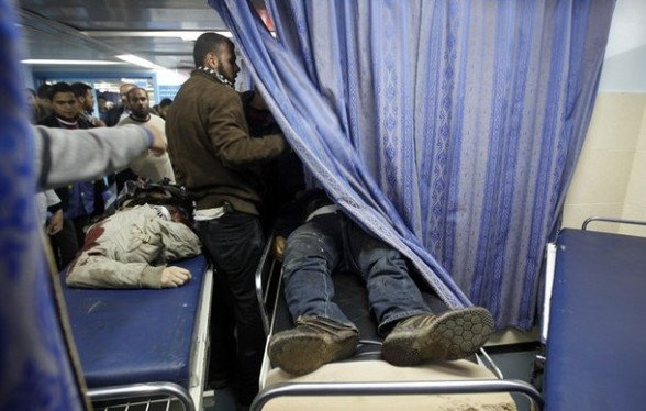The bodies of two Palestinian men arrive in hospital after a second Israeli air strike on the Gaza Strip on March 9, 2012, bringing the number of Palestinians killed in a day of cross-boarder fighting to four. The two strikes came in response to two waves of Palestinian mortar fire into southern Israel, in which no casualties were reported. AFP PHOTO/MOHAMMED ABED