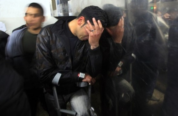A Palestinian man mourns in a hospital after two militants of the Al Quds Brigades, the military arm of Islamic Jihad, were killed in a second Israeli air strike in Gaza City on March 9, 2012, bringing the number of Palestinians killed in a day of cross-boarder fighting to four. The two strikes came in response to two waves of Palestinian mortar fire into southern Israel, in which no casualties were reported . AFP PHOTO/ MAHMUD HAMS