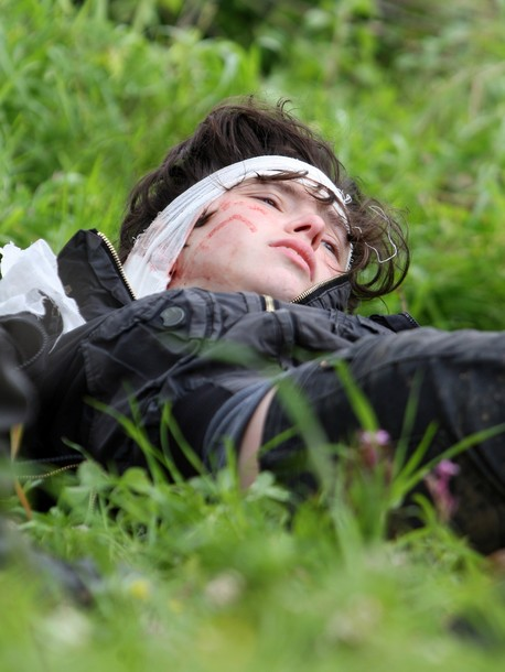 Naomi Laet, 22, an Israeli pro-Palestinian activist, lies on the ground after receiving first aid treatment from Israeli soldiers after being struck in the head by a rubber bullet during a protest in the West Bank village of Nabi Saleh, near Ramallah, on March 16, 2012 against land confiscation to build the Jewish settlement Hallamish nearby. AFP PHOTO/ABBAS MOMANI