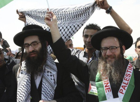 Members of Neturei Karta at the Global March Jordan to Jerusalem. Not allowed to enter Palestine. March 30, 2012