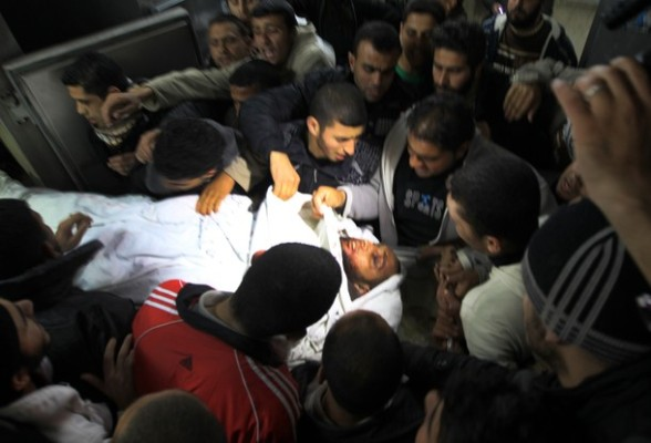 Palestinian mourn over the body islamic Jehad militant Hazem Kerekeaa in the al-Shifa hospital morgue on March 9, 2012, bringing the number of Palestinians killed in a day of cross-boarder fighting to four after a second Israeli air strike on the Gaza Strip. The two strikes came in response to two waves of Palestinian mortar fire into southern Israel, in which no casualties were reported . AFP PHOTO/ MAHMUD HAMS