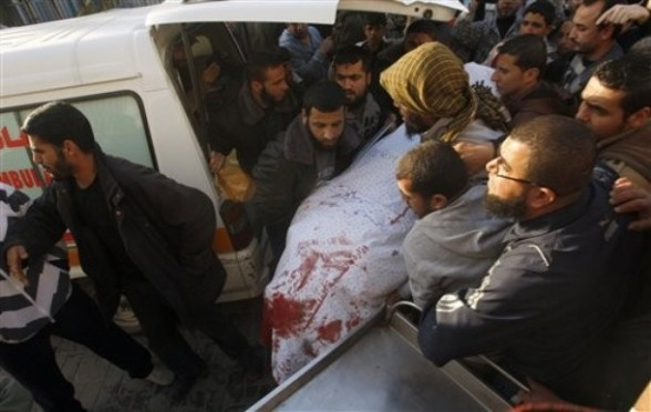 Palestinian carry the body of  Zuhair al-Qaissi, a  commander of the armed wing of the Popular Resistance Committees (PRC) in Gaza City, Friday, March 9, 2012. An Israeli airstrike killed top Palestinian militant commander Zuhair al-Qaissi and a second militant in Gaza on Friday in the highest profile attack against the coastal strip in months.(AP photo/Hatem Moussa)