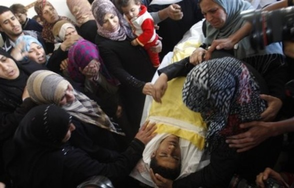 Palestinians women react over the body of Hisham Saad, during his funeral in Gaza City, Wednesday, April 4, 2012. (AP Photo/Hatem Moussa)