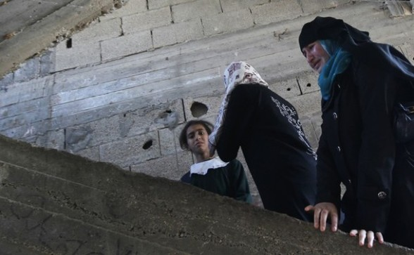 A Palestinian woman and child weep as they watch the body of Palestinian youth Hashem Saed, 17-years-old, leave his home during his funeral in Gaza City on April 4, 2012, after he was shot overnight close along the border fence between the Gaza Strip and Israel by Israeli soldiers. AFP PHOTO/MOHAMMED ABED