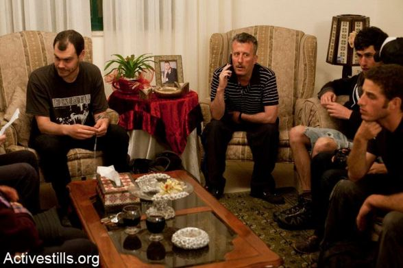 Bassem Tamimi sits with friends and relatives,in the West Bank city of Ramallah after he was released from Ofer military jail, April 24, 2012.
