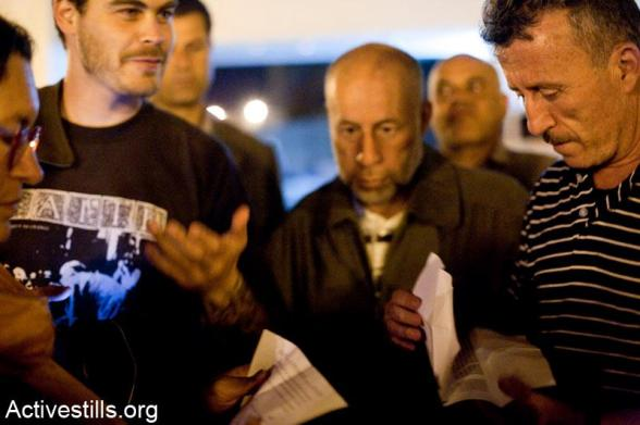 Bassem Tamimi talks to friends in the West Bank city of Ramallah after he was released from Ofer military jail, April 24, 2012.