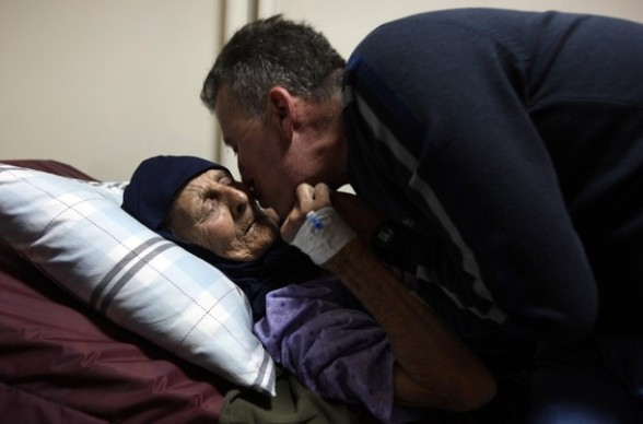 Palestinian activist Bassem Tamimi kisses his mother in at a hospital in Ramallah on April 25, 2012, after a military court released him on bail on April 24, ahead of the verdict in his trial on charges of organising popular protests. Tamimi was arrested on March 24, 2011 and accused of organising illegal demonstrations and incitement to stone-throwing in connection with a series of weekly demonstrations in the West Bank village of Nabi Saleh in protest at Jewish settlers taking over their land. AFP PHOTO / ABBAS MOMANI (Photo credit should read ABBAS MOMANI/AFP/Getty Images) 2012 AFP