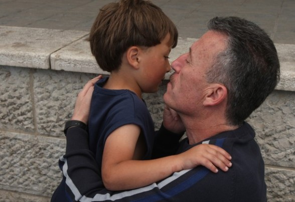 Palestinian activist Bassem Tamimi kisses a relative outside a hospital in Ramallah on April 25, 2012, after a military court released him on bail on April 24, ahead of the verdict in his trial on charges of organising popular protests. Tamimi was arrested on March 24, 2011 and accused of organising illegal demonstrations and incitement to stone-throwing in connection with a series of weekly demonstrations in the West Bank village of Nabi Saleh in protest at Jewish settlers taking over their land. AFP PHOTO / ABBAS MOMANI (Photo credit should read ABBAS MOMANI/AFP/Getty Images) 2012 AFP