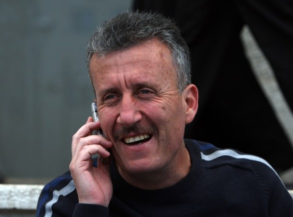 Palestinian activist Bassem Tamimi talks on the phone outside a hospital in Ramallah where his elderly mother is being treated on April 25, 2012, after a military court released him on bail on April 24, ahead of the verdict in his trial on charges of organising popular protests. Tamimi was arrested on March 24, 2011 and accused of organising illegal demonstrations and incitement to stone-throwing in connection with a series of weekly demonstrations in the West Bank village of Nabi Saleh in protest at Jewish settlers taking over their land. AFP PHOTO / ABBAS MOMANI (Photo credit should read ABBAS MOMANI/AFP/Getty Images) 2012 AFP