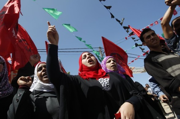 Palestinian women shout slogans during a protest calling for the release of Palestinian prisoners held in Israeli jails in Gaza City on April 25, 2012. Some 1,600 Palestinian prisoners held in Israel are conducting a mass hunger strike to protest their conditions. AFP PHOTO/ MOHAMMED ABED (Photo credit should read MOHAMMED ABED/AFP/Getty Images) 2012 AFP