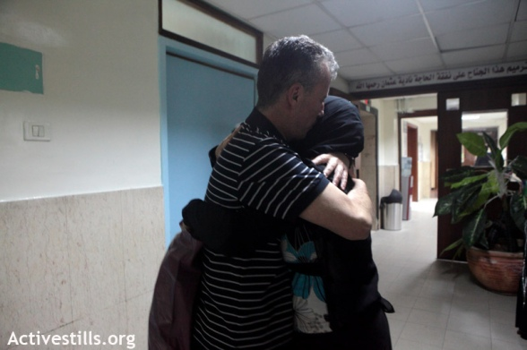 Bassem Tamimi from the West Bank village of Nabi saleh embraces his wife Nariman Tamimi after his release, Ramallah, April 24, 2012. Bassem Tamimi, one of the central figures in the popular struggle against the settlements' land theft in Nabi Saleh; was released on bail after more than a year in prison. He is not allowed to leave Ramallah area and go to his village until the final judge decision.