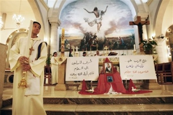 "Palestinian Christians attend a special prayer for the release of Palestinian prisoners jailed in Israel, in the West Bank city of Ramallah, Sunday, April 29, 2012. The writing in Arabic reads: ""God's soul on me, he sent me to inform the prisoners of their release - the Bible"", on the right, and ""Praised are the ones who seek peace, because they are the sons of God - the Bible.""(AP Photo/Majdi Mohammed) AP"