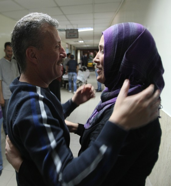 Palestinian activist Bassem Tamimi kisses a relative at a hospital in Ramallah on April 25, 2012, after a military court released him on bail on April 24, ahead of the verdict in his trial on charges of organising popular protests. Tamimi was arrested on March 24, 2011 and accused of organising illegal demonstrations and incitement to stone-throwing in connection with a series of weekly demonstrations in the West Bank village of Nabi Saleh in protest at Jewish settlers taking over their land. AFP PHOTO / ABBAS MOMANI (Photo credit should read ABBAS MOMANI/AFP/Getty Images) 2012 AFP