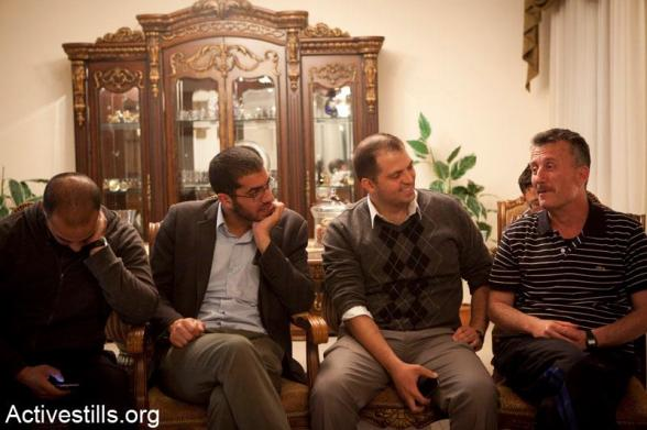 Bassem Tamimi talks with friends in the West Bank city of Ramallah after he was released from Ofer military jail, April 24, 2012.