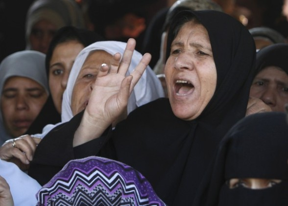 A Palestinian woman shouts during the funeral of Palestinian youth Hashem Saed, 17-years-old, as he is taken from his home for burial in Gaza City on April 4, 2012, after he was shot overnight close along the border fence between the Gaza Strip and Israel by Israeli soldiers. AFP PHOTO/MOHAMMED ABED