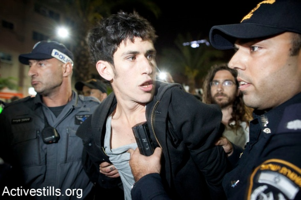 Police sieged event commemorating the Nakba, Tel Aviv, Israel, 25,4,2012Israeli anti riot policemen arrest an left wing activist, after Israeli police blocked the exit from an event of Zochrot organization, commemorating the Palestinian Nakba, in center Tel Aviv, April 25, 2012.Israeli police blocked the exit from the event, claiming activist were planing to take part in an action commemorating the Nakba, during the celebrations of the Israeli Independence day in Tel Aviv. 3 activists were arrested, while all the people in the event were asked to show their ID's in order to be able to leave the place. Photo by ActiveStills