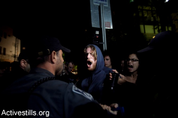 Police sieged event commemorating the Nakba, Tel Aviv, Israel, 25,4,2012Israeli anti riot policemen blcok left wing activists from exiting an event of Zochrot organization, commemorating the Palestinian Nakba, in center Tel Aviv, April 25, 2012.Israeli police blocked the exit from the event, claiming activist were planing to take part in an action commemorating the Nakba, during the celebrations of the Israeli Independence day in Tel Aviv. 3 activists were arrested, while all the people in the event were asked to show their ID's in order to be able to leave the place. Photo by Activestills