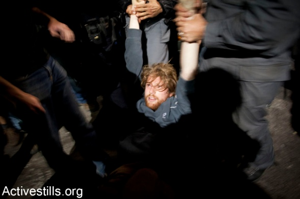 Police sieged event commemorating the Nakba, Tel Aviv, Israel, 25,4,2012Israeli anti riot policemen arrest an left wing activist, after Israeli police blocked the exit from an event of Zochrot organization, commemorating the Palestinian Nakba, in center Tel Aviv, April 25, 2012.Israeli police blocked the exit from the event, claiming activist were planing to take part in an action commemorating the Nakba, during the celebrations of the Israeli Independence day in Tel Aviv. 3 activists were arrested, while all the people in the event were asked to show their ID's in order to be able to leave the place. - Photo by ActiveStills