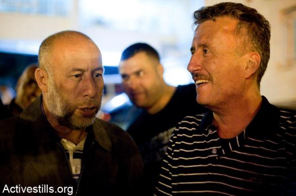 Bassem Tamimi talks with Naji Tamimi in the West Bank city of Ramallah after he was released from Ofer military jail, April 24, 2012.