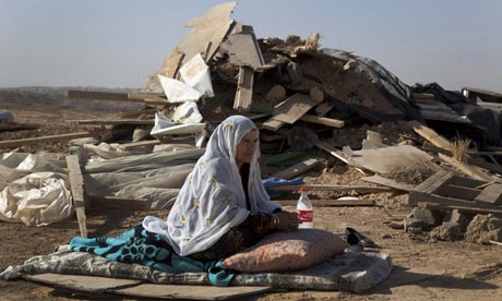 A bedouin woman from al-Turi family sits in front of the rubble of her home demolished by Israel (file photo)