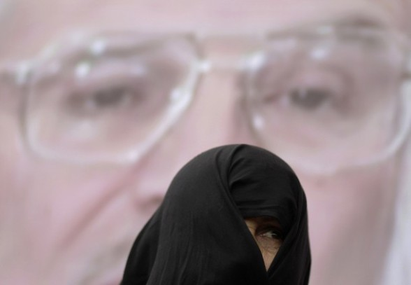 A Palestinian woman attends a rally to show solidarity with Palestinian prisoners held in Israeli jails, in Gaza City, April 30, 2012. Human rights groups say up to 2,000 prisoners have joined an open-ended hunger strike to protest against jail conditions. REUTERS/Mohammed Salem