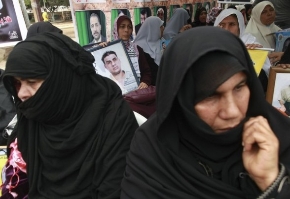 Palestinian women attend a rally  to show solidarity with Palestinians prisoners held in Israeli jails, in Gaza City, April 30, 2012. Human rights groups say up to 2,000 prisoners have joined an open-ended hunger strike to protest against jail conditions. REUTERS/Mohammed Salem