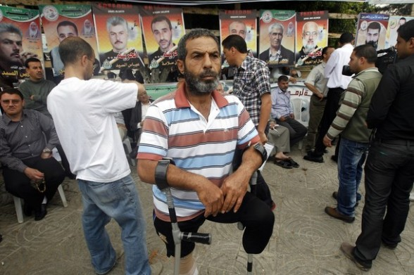 A disabled Palestinian man takes part in a rally in Gaza City in support of more than a thousand prisoners who are on an open-ended hunger strike in Israeli jails on April 30, 2012. At least 1,350 Palestinian prisoners held in Israel are conducting a general hunger strike to protest their conditions. AFP PHOTO/MOHAMMED ABED