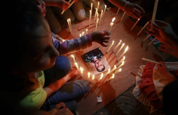 Palestinians light candles during a rally in Gaza City to show solidarity with Palestinian prisoners held in Israeli jails