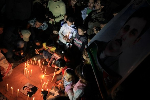 Palestinian children place candles on the ground during an evening demonstration in Gaza City calling for the release of Palestinians being held in Israeli jails on April 28, 2012. Some 1,600 Palestinian prisoners held in Israel are conducting a mass hunger strike to protest their conditions. AFP PHOTO/MAHMUD HAMS