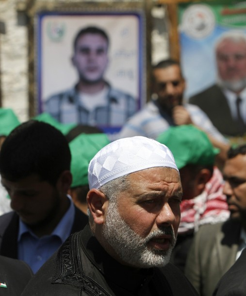 Palestinian Hamas Leader Hamas Ismail Haniya attends a protest in solidarity with Palestinian prisoners being held in Israeli jails, following the Friday noon prayers, in Gaza City, on April 20, 2012. AFP PHOTO/MOHAMMED ABED