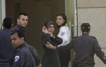 Hana Shalabi (C) is escorted by Israeli prison guards upon her arrival to Erez border crossing between Israel and the northern Gaza Strip April 1, 2012.