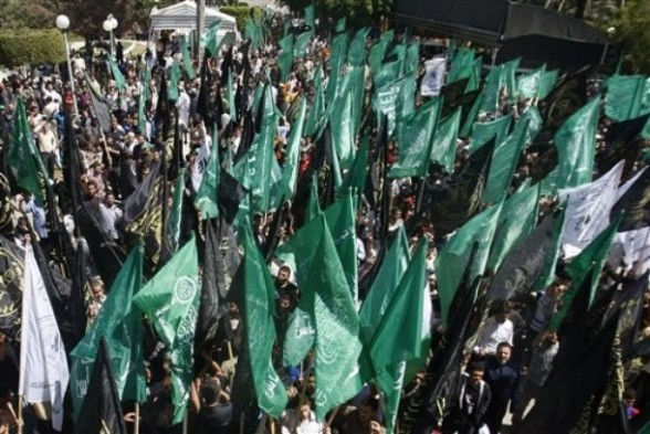 Palestinians from Hamas and Islamic Jihad movements rally for the release of Palestinian prisoners from Israeli jails, in Gaza City, Friday, April 27, 2012. Over 4,000 Palestinians are jailed in Israel. (AP photo/Hatem Moussa)