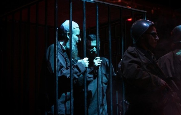 Palestinians perform a play depicting Palestinian prisoners in an Israeli jail in Gaza City on April 16, 2012 on the eve of Prisoners' Day, an annual event during which people hold demonstrations and rallies of solidarity with the estimated 4,700 Palestinian inmates being held by Israel. AFP PHOTO/MAHMUD HAMS