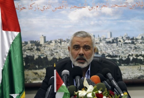 Hamas leader Ismail Haniya gives a speech on the occasion of the Palestinian Prisoner Day in Gaza City on April 16, 2012. Some 1,600 Palestinian prisoners held in Israel are due Sto begin a mass hunger strike on April 17 to protest their conditions, a Palestinian minister said.  AFP PHOTO/MOHAMMED ABED