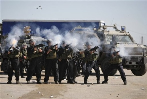"""Israeli troops fire teargas at Palestinian protesters during clashes outside Ofer military prison near the West Bank city of Ramallah, on the annual """"Prisoners' Day"""", Tuseday, April 17, 2012.  Hundreds of Palestinian prisoners held by Israel launched a hunger strike on Tuesday, officials said, protesting their conditions and demanding an end to detentions without trial as the Palestinians marked their annual day of solidarity with the inmates.(AP Photo/Majdi Mohammed)"""