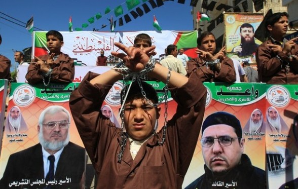 Palestinians demonstrate in Gaza City on April 17, 2012 in solidarity with prisoners held in Israel.  Some 1,200 Palestinian prisoners held in Israeli jails have begun a hunger strike and another 2,300 are refusing food for one day, a spokeswoman for the Israel Prisons Service (IPS) said as Palestinians across the West Bank and Gaza Strip were marking Prisoners' Day in solidarity with the 4,700 Palestinian inmates of Israeli jails. AFP PHOTO/MAHMUD HAMS