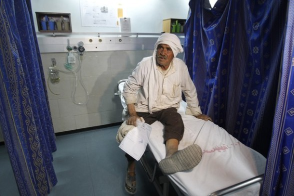 A Palestinian farmer waits for check up at a hospital  in Gaza City on May 17, 2012, following Israeli shelling into the Gaza Strip in which seven people were wounded, two of them in critical condition, near the Karni crossing.  The Israeli military maintains an exclusion zone inside the Gaza Strip along the border and regularly carries out military activity in the area.    AFP PHOTO/MOHAMMED ABED
