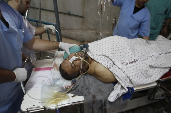 Palestinian medics attend to a wounded man at a hospital  in Gaza City on May 17, 2012, following Israeli shelling into the Gaza Strip in which seven people were injured, two of them in critical condition, near the Karni crossing.  The Israeli military maintains an exclusion zone inside the Gaza Strip along the border and regularly carries out military activity in the area.    AFP PHOTO/MOHAMMED ABED