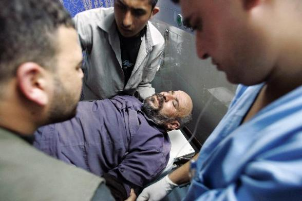 Wounded in hospital  after Israeli assault on Gaza - Photo by Reuters