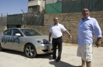 "Palestinian man gestures towards a car sprayed with graffiti written in Hebrew that reads, ""Ulpena"" referring to the Jewish outpost built illegally in in the West Bank and which is earmarked to be relocated following a supreme court order, in the Palestinian neighborhood of Shuafat, in Israeli annexed East Jerusalem, on June 11, 2012.  Unknown attackers vandalised Palestinian cars in east Jerusalem, slashing tyres and spraying pro-settler Hebrew graffiti on the vehicles in the latest apparent hate crime, police said. AFP PHOTO/AHMAD GHARABLI"