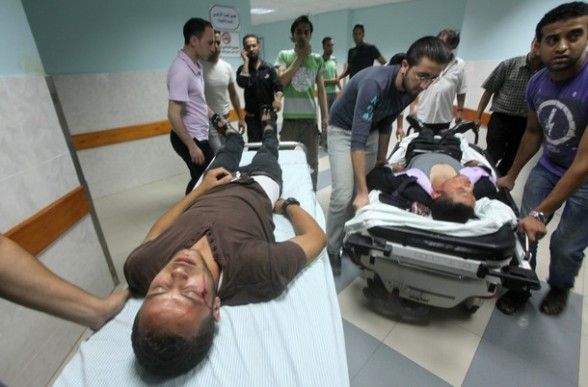 Wounded men are wheeled into the emergency room of a hospital following an Israeli strike on Gaza City on June 23, 2012.  A Palestinian teenager riding a motorcycle was killed, and 10 passers-by wounded in a fresh Israeli air strike on the Gaza Strip Palestinian medics said, bringing the death toll from the current Israeli raids to three.  AFP PHOTO/STR
