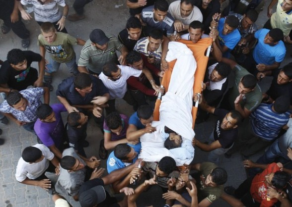 "Palestinians carry the body of six-year-old Ali Al-Shwaf during his funeral in Khan Younis, in the southern Gaza Strip June 23, 2012. Hamas medical officials said a six-year-old Palestinian boy had been killed in an air strike and that a baby had been hurt in a separate raid near the Egyptian border. Israel denied involvement in hurting either of the children. Lieutenant Colonel Avital Leibovich, an Israeli military spokeswoman, said on Twitter that the report of Israeli responsibility in the death of the six-year-old was the result of ""false rumours"" and that the boy had died due to an explosion of ordnance belonging to Palestinian militants. Another Israeli military spokeswoman said she had no report of any air strikes in Rafah, where the baby was reported to have been hurt.  REUTERS/Ibraheem Abu Mustafa"