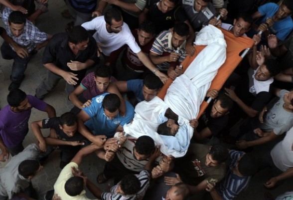 Palestinians carry the body of six-year-old Ali al-Shwaf during his funeral in Khan Younis, in the southern Gaza Strip on June 23, 2012, after he was killed during an Israeli air strike in Gaza as his father and another man were wounded in the shelling, but the Israeli military denied it was responsible. AFP PHOTO/SAID KHATIB