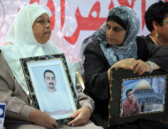 Family at the weekly sit in for prisoners and hunger strikers in Ramallah - June 12, 2012 Photo by WAFA