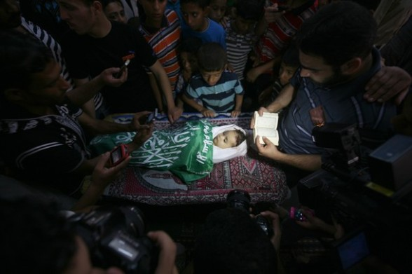 Palestinian mourners pray over the body of two-year-old girl, Hadeel al-Hadad, in the mosque during her funeral in Gaza City, on June 20, 2012.  (Photo credit MAHMUD HAMS/AFP/GettyImages)