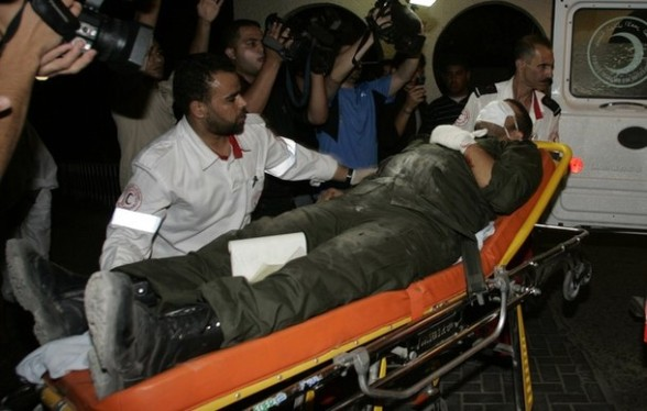 A wounded member of Hamas' security forces is wheeled into al-Shifa hospital after Israeli air raids hit Hamas security sites in Gaza City June 23, 2012. Israel launched air raids early on Saturday against three Hamas security targets in the Gaza Strip, wounding at least 17 people,  Hamas medical officials said.  REUTERS/Ahmed Zakot